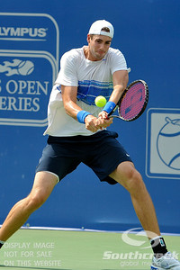 John Isner (USA) hits a backhand against Yen-Hsun Lu (TPE) during their quarterfinal match.  John Isner defeated Yen-Hsun Lu in straight sets 6-1, 6-2 in Quarterfinal Action on Friday  in the Atlanta Tennis Championships at the Racquet Club of the South in Norcross, GA.