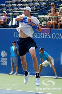 John Isner (USA) shows good form on the follow through against Yen-Hsun Lu (TPE) during their quarterfinal match.  John Isner defeated Yen-Hsun Lu in straight sets 6-1, 6-2 in Quarterfinal Action on Friday  in the Atlanta Tennis Championships at the Racquet Club of the South in Norcross, GA.