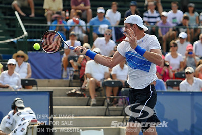 John Isner (USA) powers a forehand volley against Yen-Hsun Lu (TPE) during their quarterfinal match.  John Isner defeated Yen-Hsun Lu in straight sets 6-1, 6-2 in Quarterfinal Action on Friday  in the Atlanta Tennis Championships at the Racquet Club of the South in Norcross, GA.