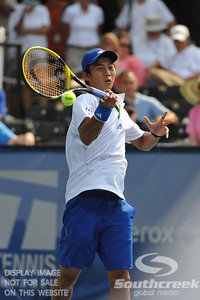 Yen-Hsun Lu (TPE) hits a forehand volley against John Isner (USA) during their quarterfinal match.  John Isner defeated Yen-Hsun Lu in straight sets 6-1, 6-2 in Quarterfinal Action on Friday  in the Atlanta Tennis Championships at the Racquet Club of the South in Norcross, GA.