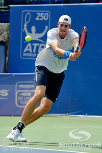 John Isner (USA) lunges for a shot by Yen-Hsun Lu (TPE) during their quarterfinal match.  John Isner defeated Yen-Hsun Lu in straight sets 6-1, 6-2 in Quarterfinal Action on Friday  in the Atlanta Tennis Championships at the Racquet Club of the South in Norcross, GA.