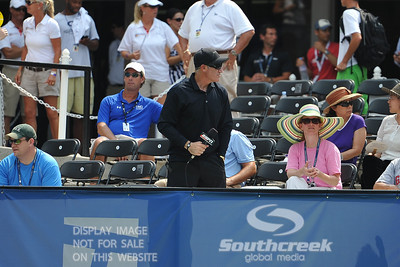 ESPN's Brad Gilbert gets ready to take his courtside seat for the Quarterfinal match featuring John Isner (USA) vs Yen-Hsun Lu (TPE).  John Isner defeated Yen-Hsun Lu in straight sets 6-1, 6-2 in Quarterfinal Action on Friday  in the Atlanta Tennis Championships at the Racquet Club of the South in Norcross, GA.