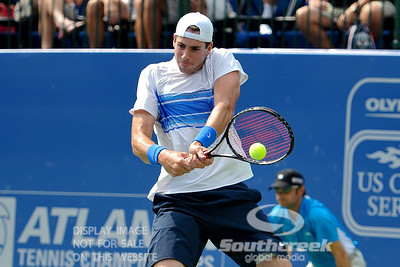 John Isner (USA) powers a backhand back to Yen-Hsun Lu (TPE) during their quarterfinal match.  John Isner defeated Yen-Hsun Lu in straight sets 6-1, 6-2 in Quarterfinal Action on Friday  in the Atlanta Tennis Championships at the Racquet Club of the South in Norcross, GA.