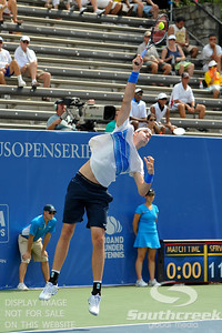 John Isner (USA) serves during their quarterfinal match.  John Isner defeated Yen-Hsun Lu in straight sets 6-1, 6-2 in Quarterfinal Action on Friday  in the Atlanta Tennis Championships at the Racquet Club of the South in Norcross, GA.