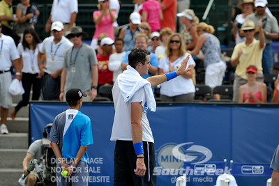 John Isner (USA) thanks the fans after the quarterfinal match.  John Isner defeated Yen-Hsun Lu in straight sets 6-1, 6-2 in Quarterfinal Action on Friday  in the Atlanta Tennis Championships at the Racquet Club of the South in Norcross, GA.