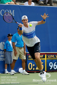 John Isner (USA) reaches out for a forehand against Yen-Hsun Lu (TPE) during their quarterfinal match.  John Isner defeated Yen-Hsun Lu in straight sets 6-1, 6-2 in Quarterfinal Action on Friday  in the Atlanta Tennis Championships at the Racquet Club of the South in Norcross, GA.