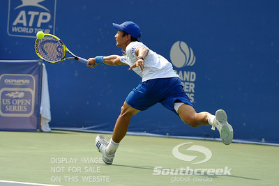 Yen-Hsun Lu (TPE) barely gets to this John Isner (USA) shot during their quarterfinal match.  John Isner defeated Yen-Hsun Lu in straight sets 6-1, 6-2 in Quarterfinal Action on Friday  in the Atlanta Tennis Championships at the Racquet Club of the South in Norcross, GA.