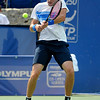 John Isner (USA) gets jammed on a backhand against Yen-Hsun Lu (TPE) during their quarterfinal match.  John Isner defeated Yen-Hsun Lu in straight sets 6-1, 6-2 in Quarterfinal Action on Friday  in the Atlanta Tennis Championships at the Racquet Club of the South in Norcross, GA.