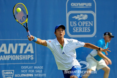 Yen-Hsun Lu (TPE) reaches for a serve by John Isner (USA) during their quarterfinal match.  John Isner defeated Yen-Hsun Lu in straight sets 6-1, 6-2 in Quarterfinal Action on Friday  in the Atlanta Tennis Championships at the Racquet Club of the South in Norcross, GA.