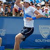John Isner (USA) follows through on a forehand volley against Yen-Hsun Lu (TPE) during their quarterfinal match.  John Isner defeated Yen-Hsun Lu in straight sets 6-1, 6-2 in Quarterfinal Action on Friday  in the Atlanta Tennis Championships at the Racquet Club of the South in Norcross, GA.