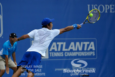 Yen-Hsun Lu (TPE) reaches for a John Isner (USA) shot during their quarterfinal match.  John Isner defeated Yen-Hsun Lu in straight sets 6-1, 6-2 in Quarterfinal Action on Friday  in the Atlanta Tennis Championships at the Racquet Club of the South in Norcross, GA.
