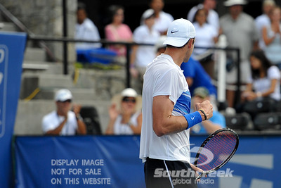 John Isner (USA) gives a fist pump towards his coach after defeating Yen-Hsun Lu (TPE) in their quarterfinal match.  John Isner defeated Yen-Hsun Lu in straight sets 6-1, 6-2 in Quarterfinal Action on Friday  in the Atlanta Tennis Championships at the Racquet Club of the South in Norcross, GA.