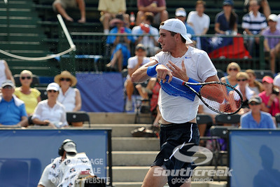 John Isner (USA) leaves a trail of tennis ball fuzz after a forehand winner against Yen-Hsun Lu (TPE) during their quarterfinal match.  John Isner defeated Yen-Hsun Lu in straight sets 6-1, 6-2 in Quarterfinal Action on Friday  in the Atlanta Tennis Championships at the Racquet Club of the South in Norcross, GA.