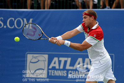 Gilles Muller (LUX) guides his backhand shot during the second round.  Gilles Muller defeated Robby Ginepri in three sets 7-6(6), 2-6, 6-2 in Second Round Action on Wednesday in the Atlanta Tennis Championships at the Racquet Club of the South in Norcross, GA.