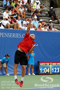 Robby Ginepri (USA) serves during the second round.  Gilles Muller defeated Robby Ginepri in three sets 7-6(6), 2-6, 6-2 in Second Round Action on Wednesday in the Atlanta Tennis Championships at the Racquet Club of the South in Norcross, GA.