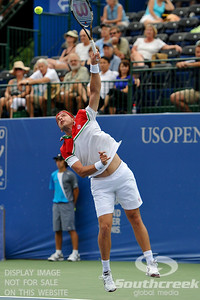 Gilles Muller (LUX) serves during the second round.  Gilles Muller defeated Robby Ginepri in three sets 7-6(6), 2-6, 6-2 in Second Round Action on Wednesday in the Atlanta Tennis Championships at the Racquet Club of the South in Norcross, GA.