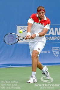Gilles Muller (LUX) hits a two handed backhand during the second round.  Gilles Muller defeated Robby Ginepri in three sets 7-6(6), 2-6, 6-2 in Second Round Action on Wednesday in the Atlanta Tennis Championships at the Racquet Club of the South in Norcross, GA.