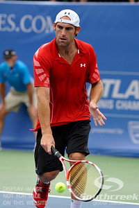 Robby Ginepri (USA) goes down low for a backhand during the second round.  Gilles Muller defeated Robby Ginepri in three sets 7-6(6), 2-6, 6-2 in Second Round Action on Wednesday in the Atlanta Tennis Championships at the Racquet Club of the South in Norcross, GA.