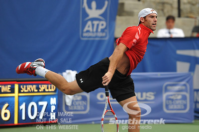 Robby Ginepri (USA) follows through on his serve during the second round.  Gilles Muller defeated Robby Ginepri in three sets 7-6(6), 2-6, 6-2 in Second Round Action on Wednesday in the Atlanta Tennis Championships at the Racquet Club of the South in Norcross, GA.