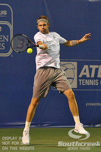 Mardy Fish (USA) leans back into a forehand during the second round.  Mardy Fish defeated Nicolas Mahut in straight sets 6-3, 6-3 in Second Round Action on Thursday in the Atlanta Tennis Championships at the Racquet Club of the South in Norcross, GA.