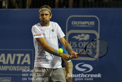 Mardy Fish (USA) concentrates on his two handed backhand during the second round.  Mardy Fish defeated Nicolas Mahut in straight sets 6-3, 6-3 in Second Round Action on Thursday in the Atlanta Tennis Championships at the Racquet Club of the South in Norcross, GA.