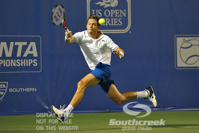 Nicolas Mahut (FRA) hits a running forehand during the second round.  Mardy Fish defeated Nicolas Mahut in straight sets 6-3, 6-3 in Second Round Action on Thursday in the Atlanta Tennis Championships at the Racquet Club of the South in Norcross, GA.