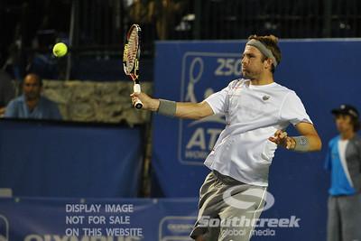 Mardy Fish (USA) fights off a tough serve during the second round.  Mardy Fish defeated Nicolas Mahut in straight sets 6-3, 6-3 in Second Round Action on Thursday in the Atlanta Tennis Championships at the Racquet Club of the South in Norcross, GA.