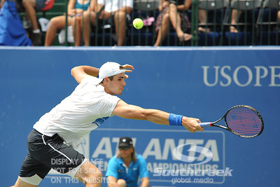 John Isner (USA) reaches for a backhand during the semifinal match. John Isner defeated Gilles Muller in three sets 7-5, 6-7, 6-1 in the Semifinal Match on Saturday in the Atlanta Tennis Championships at the Racquet Club of the South in Norcross, GA.