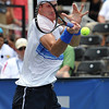 John Isner (USA) hits a forehand against Gilles Muller (LUX) during the semifinal match. John Isner defeated Gilles Muller in three sets 7-5, 6-7, 6-1 in the Semifinal Match on Saturday in the Atlanta Tennis Championships at the Racquet Club of the South in Norcross, GA.