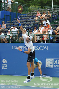 John Isner (USA) serves to Gilles Muller (LUX) during the semifinal match. John Isner defeated Gilles Muller in three sets 7-5, 6-7, 6-1 in the Semifinal Match on Saturday in the Atlanta Tennis Championships at the Racquet Club of the South in Norcross, GA.