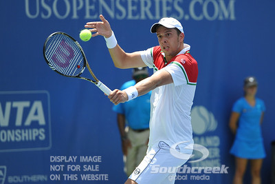 Gilles Muller (LUX) hits a slice backhand against John Isner (USA) during the semifinal match. John Isner defeated Gilles Muller in three sets 7-5, 6-7, 6-1 in the Semifinal Match on Saturday in the Atlanta Tennis Championships at the Racquet Club of the South in Norcross, GA.