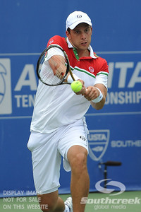 Gilles Muller (LUX) hits a backhand against John Isner (USA) during the semifinal match. John Isner defeated Gilles Muller in three sets 7-5, 6-7, 6-1 in the Semifinal Match on Saturday in the Atlanta Tennis Championships at the Racquet Club of the South in Norcross, GA.