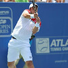 Gilles Muller (LUX) hits an awkward backhand against John Isner (USA) during the semifinal match. John Isner defeated Gilles Muller in three sets 7-5, 6-7, 6-1 in the Semifinal Match on Saturday in the Atlanta Tennis Championships at the Racquet Club of the South in Norcross, GA.