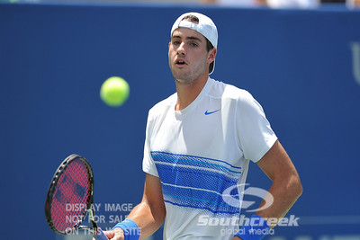 John Isner (USA) keeps a close eye on the ball during the semifinal match. John Isner defeated Gilles Muller in three sets 7-5, 6-7, 6-1 in the Semifinal Match on Saturday in the Atlanta Tennis Championships at the Racquet Club of the South in Norcross, GA.