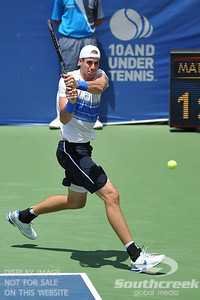 John Isner (USA) hits a running backhand during the semifinal match. John Isner defeated Gilles Muller in three sets 7-5, 6-7, 6-1 in the Semifinal Match on Saturday in the Atlanta Tennis Championships at the Racquet Club of the South in Norcross, GA.