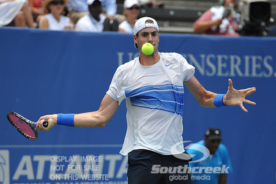 John Isner (USA) keeps his eye on the ball during the semifinal match. John Isner defeated Gilles Muller in three sets 7-5, 6-7, 6-1 in the Semifinal Match on Saturday in the Atlanta Tennis Championships at the Racquet Club of the South in Norcross, GA.