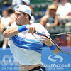 John Isner (USA) follows through on a forehand during the semifinal match. John Isner defeated Gilles Muller in three sets 7-5, 6-7, 6-1 in the Semifinal Match on Saturday in the Atlanta Tennis Championships at the Racquet Club of the South in Norcross, GA.