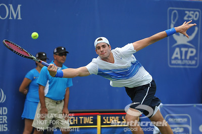 John Isner (USA) reaches for a shot by Gilles Muller (LUX) during the semifinal match. John Isner defeated Gilles Muller in three sets 7-5, 6-7, 6-1 in the Semifinal Match on Saturday in the Atlanta Tennis Championships at the Racquet Club of the South in Norcross, GA.