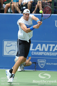 John Isner (USA) hits a backhand during the semifinal match. John Isner defeated Gilles Muller in three sets 7-5, 6-7, 6-1 in the Semifinal Match on Saturday in the Atlanta Tennis Championships at the Racquet Club of the South in Norcross, GA.