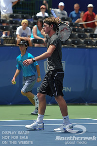 Austin Smith (USA) walks off the court frustrated after his qualifying match against Denis Kudla (USA).  Denis Kudla defeated Austin Smith in straight sets 6-4, 6-4 in the Sunday Qualifier at the Atlanta Tennis Championships at the Racquet Club of the South in Norcross, GA.