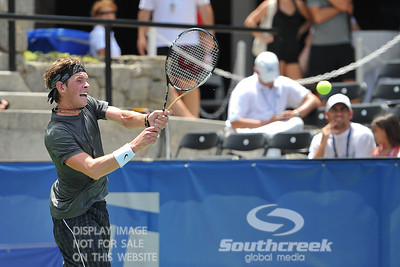 Austin Smith (USA) hits a backhand against Denis Kudla (USA) during a qualifying match.  Denis Kudla defeated Austin Smith in straight sets 6-4, 6-4 in the Sunday Qualifier at the Atlanta Tennis Championships at the Racquet Club of the South in Norcross, GA.