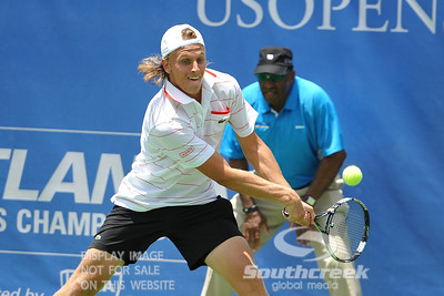 Denis Kudla (USA) reaches for a backhand against Austin Smith (USA) during a qualifying match.  Denis Kudla defeated Austin Smith in straight sets 6-4, 6-4 in the Sunday Qualifier at the Atlanta Tennis Championships at the Racquet Club of the South in Norcross, GA.