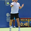 Denis Kudla (USA) hits a forehand to Austin Smith (USA) during a qualifying match.  Denis Kudla defeated Austin Smith in straight sets 6-4, 6-4 in the Sunday Qualifier at the Atlanta Tennis Championships at the Racquet Club of the South in Norcross, GA.