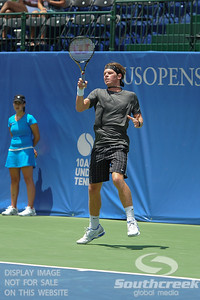 Austin Smith (USA) follows through on a forehand against Denis Kudla (USA) during a qualifying match.  Denis Kudla defeated Austin Smith in straight sets 6-4, 6-4 in the Sunday Qualifier at the Atlanta Tennis Championships at the Racquet Club of the South in Norcross, GA.