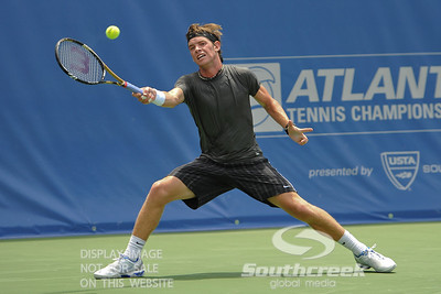 Austin Smith (USA) reaches for a forehand against Denis Kudla (USA) during a qualifying match.  Denis Kudla defeated Austin Smith in straight sets 6-4, 6-4 in the Sunday Qualifier at the Atlanta Tennis Championships at the Racquet Club of the South in Norcross, GA.