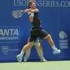 Austin Smith (USA) goes airborne on his follow through against Denis Kudla (USA) during a qualifying match.  Denis Kudla defeated Austin Smith in straight sets 6-4, 6-4 in the Sunday Qualifier at the Atlanta Tennis Championships at the Racquet Club of the South in Norcross, GA.