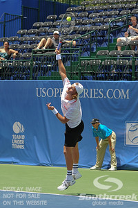 Denis Kudla (USA) serves to Austin Smith (USA) during a qualifying match.  Denis Kudla defeated Austin Smith in straight sets 6-4, 6-4 in the Sunday Qualifier at the Atlanta Tennis Championships at the Racquet Club of the South in Norcross, GA.