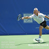 Denis Kudla (USA) reaches for a serve unsuccessfully against Austin Smith (USA) during a qualifying match.  Denis Kudla defeated Austin Smith in straight sets 6-4, 6-4 in the Sunday Qualifier at the Atlanta Tennis Championships at the Racquet Club of the South in Norcross, GA.