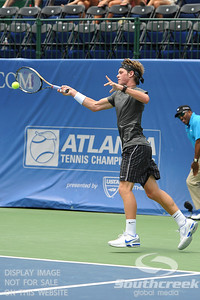 Austin Smith (USA) hits a forehand to Denis Kudla (USA) during a qualifying match.  Denis Kudla defeated Austin Smith in straight sets 6-4, 6-4 in the Sunday Qualifier at the Atlanta Tennis Championships at the Racquet Club of the South in Norcross, GA.