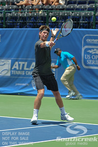 Austin Smith (USA) hits a backhand to Denis Kudla (USA) during a qualifying match.  Denis Kudla defeated Austin Smith in straight sets 6-4, 6-4 in the Sunday Qualifier at the Atlanta Tennis Championships at the Racquet Club of the South in Norcross, GA.